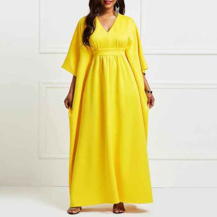 Желтое длинное платье.